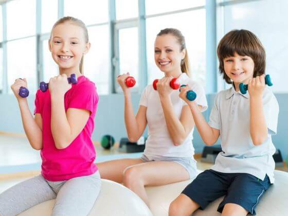 Kids lifting weights